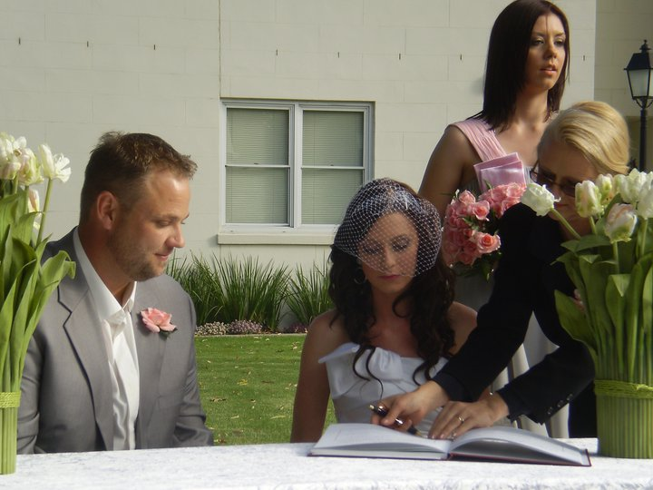 Time for a breather while signing the register. The ceremony is almost over